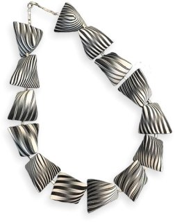 Carol Blackburn twists black and white in new ways on PolymerClayDaily.com