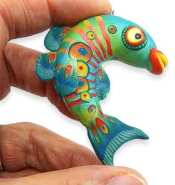 Fiona Abel Smith inlays stripes over a blend for her tropical fish on PolymerClayDaily.com