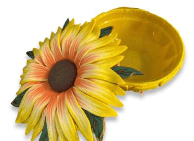 The lids on Gael Keyes trinket bowls celebrate the garden