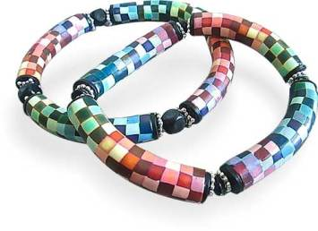 Deb Hart explores the rainbow in her pixelated cane bangles on PolymerClayDaily.com