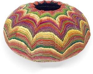 Olga Perova's patterns zig and zag around this vase on PolymerClayDaily.com