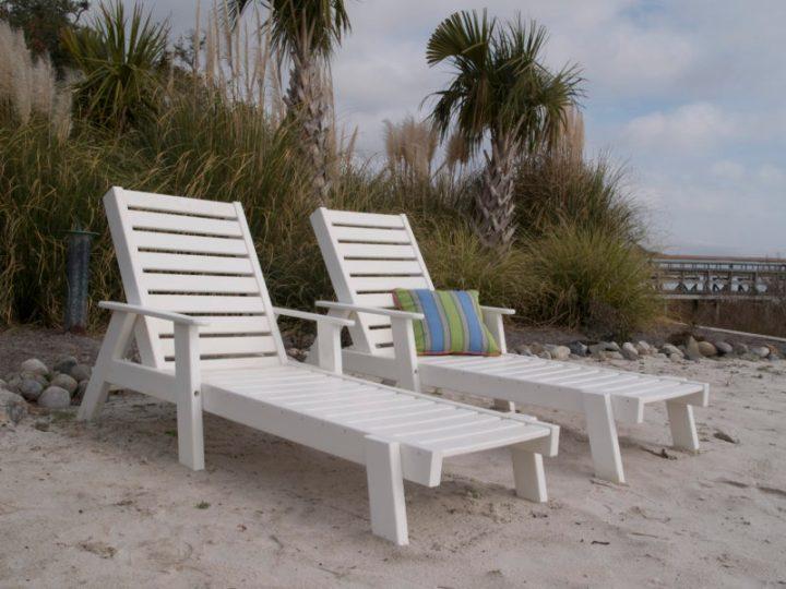 white chaise lounge chairs on beach