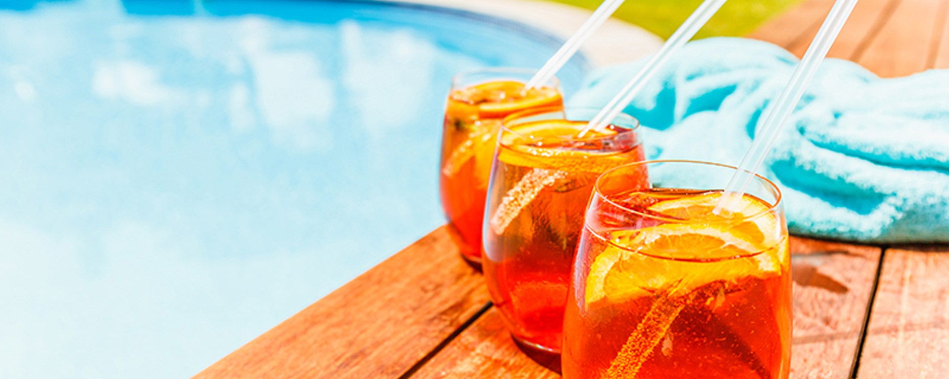 Drinks by the pool at outdoor bar patio
