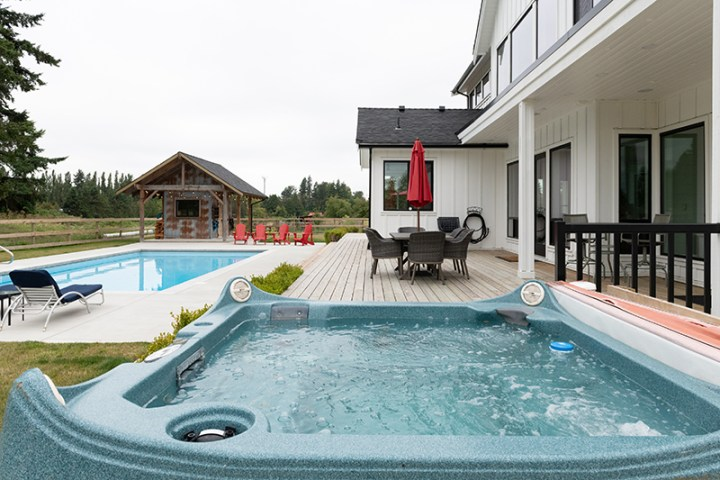 Hot tub and pool at a modern upscale suburban home