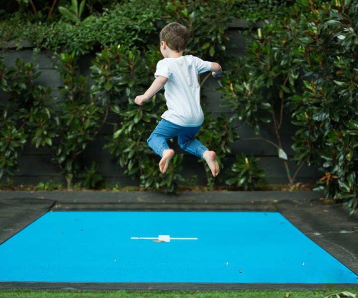 Active kids - Happy unidentified child being active outside jumping on trampoline.