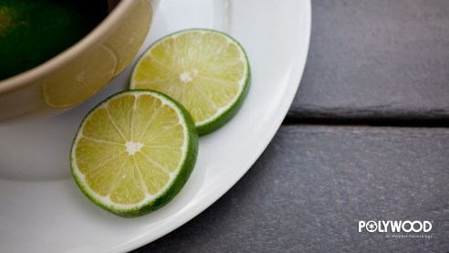 sliced limes up close on plate wallpaper