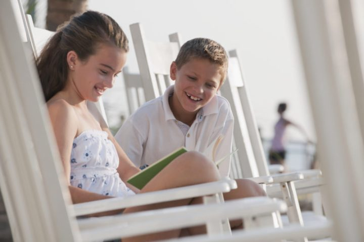 kids reading on rocking chairs