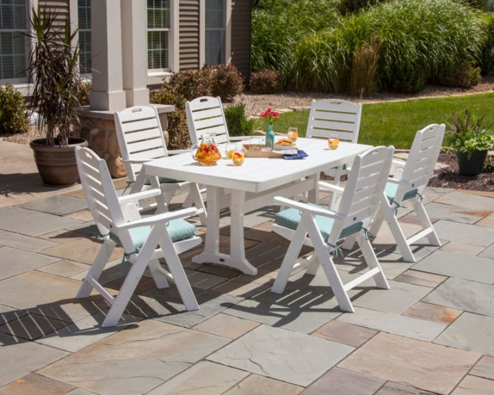 white 7 piece dining set in backyard