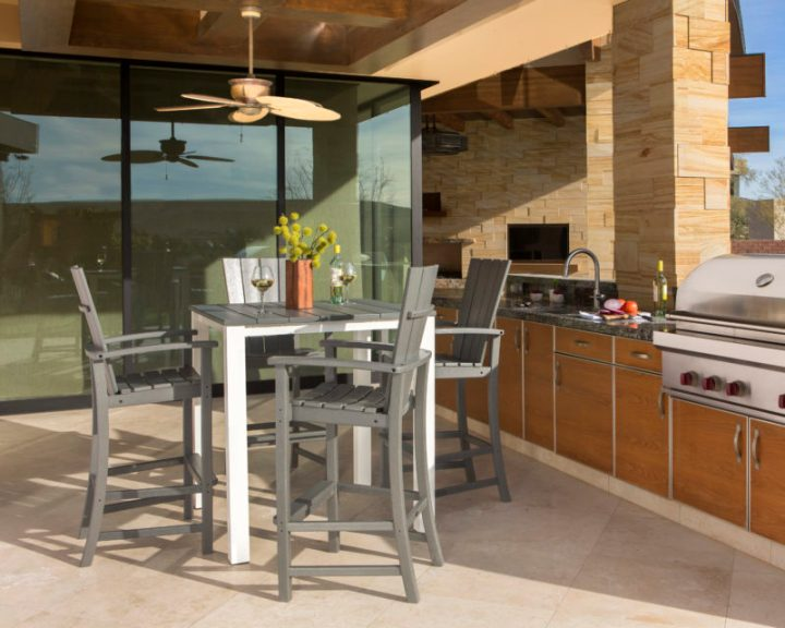outdoor kitchen with grey bar chairs