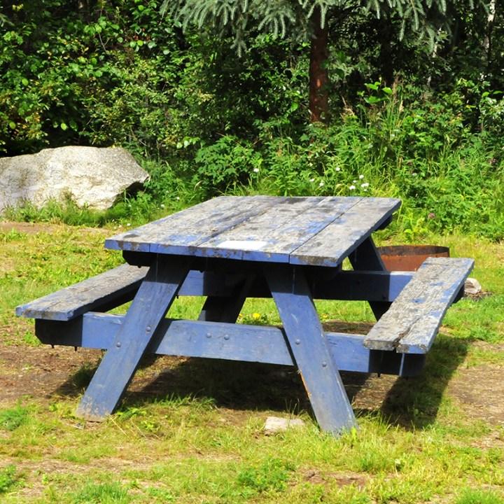 light blue worn picnic table