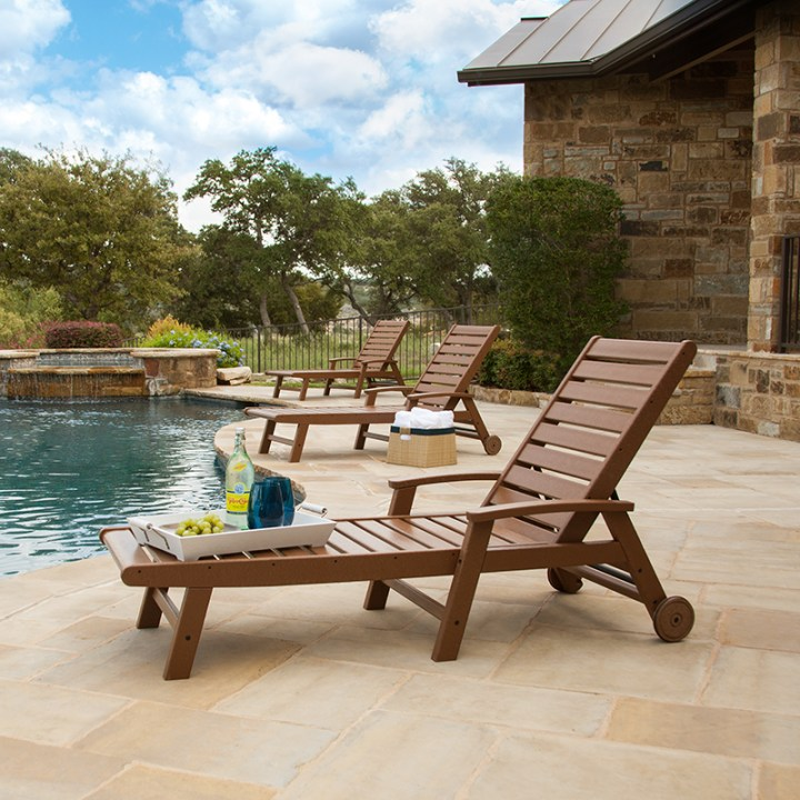 3 brown polywood chaise lounges by pool