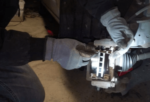 how to on tools needed to change rotors and replace front and rear brake pads without bleeding including brake caliber tool, pad spreader, brake bleeder wrench, lug nut wrench, and jack stand