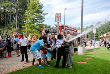 "Deputy County Manager Dr. Jackie McMorris and Director Heaton lead the ceremonial ""uncoupling of the hose""."