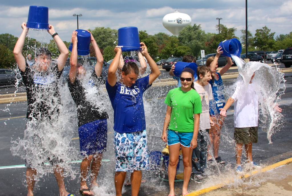 Slacktivism: ALS Ice Bucket Challenge - band kids take the plunge after the band carwash. Don't worry, it's clean water!