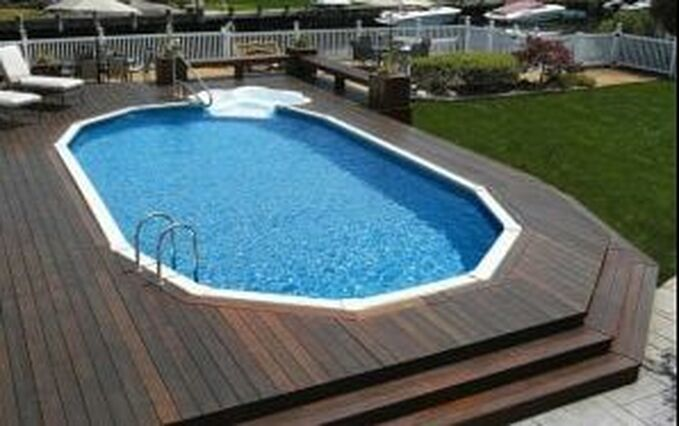 Doughboy Pool Installed Semi Inground with in wall step and Deck
