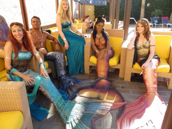 Mermaids and merman at the pool party