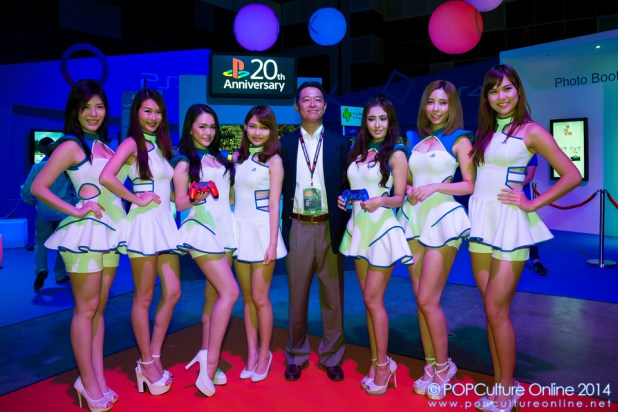 GameStart 2014 Mr Hiroyuki Oda with the playstation booth girls at the sony playstation booth