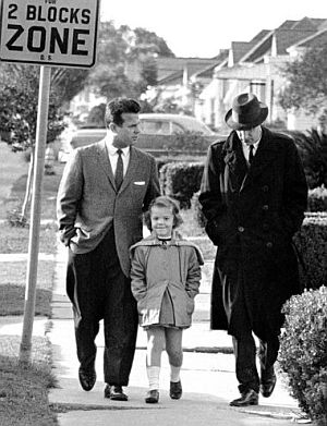Nov 29, 1960: White parent, Rev. Lloyd Foreman (left) walks his five-year-old daughter Pam to the newly integrated William Frantz School where they were blocked by jeering crowd. At right is AP reporter Dave Zinman. AP photo.