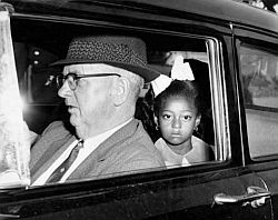 A federal marshal driving first grader Gail Etienne to McDonogh 19 school in New Orleans, November 14, 1960, one of four black children who entered two previously all-white schools in the city. Times-Picayune photo.
