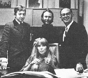 Joni Mitchell at Reprise contract signing, March 1968, with (l-to-r), Elliot Roberts, David Crosby, and Mo Ostin.