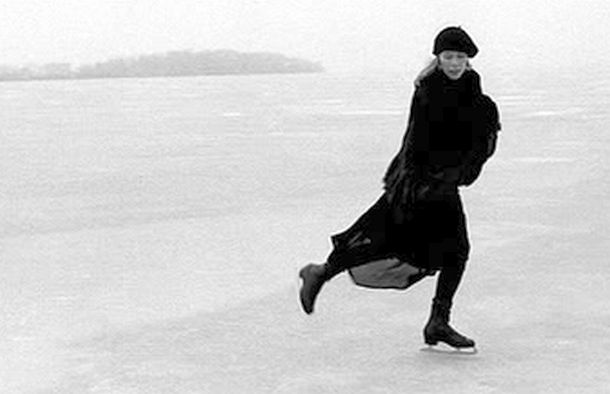 Joni Mitchell skating on frozen Lake Mendota, near Madison, Wisconsin, 'Picnic Point' behind her, March 1976. Photo, Joel Bernstein. Also used on her 'Songs of a Prairie Girl' album (2005). Click for album.