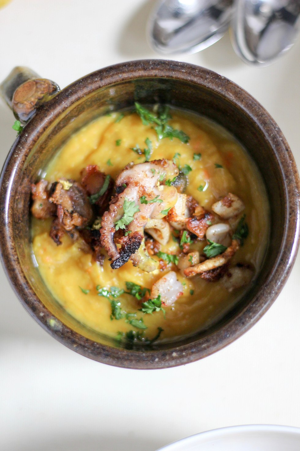 Creamy turmeric split pea seafood chowder for the cool winter months | POP KITCHEN