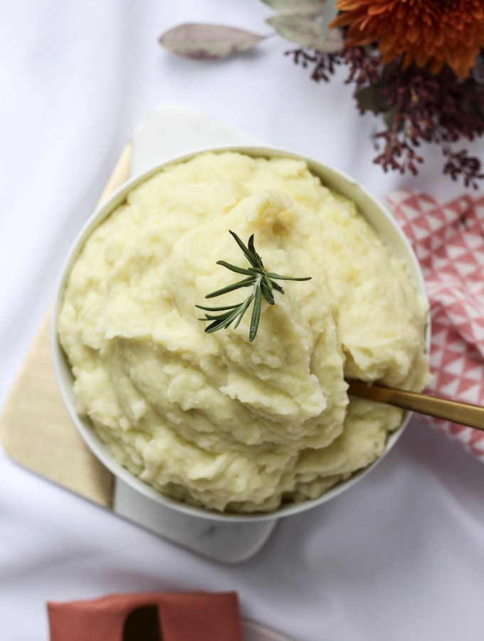 Rosemary infused mashed potatoes are rich, fluffy and fragrant with rosemary and garlic // POP KITCHEN