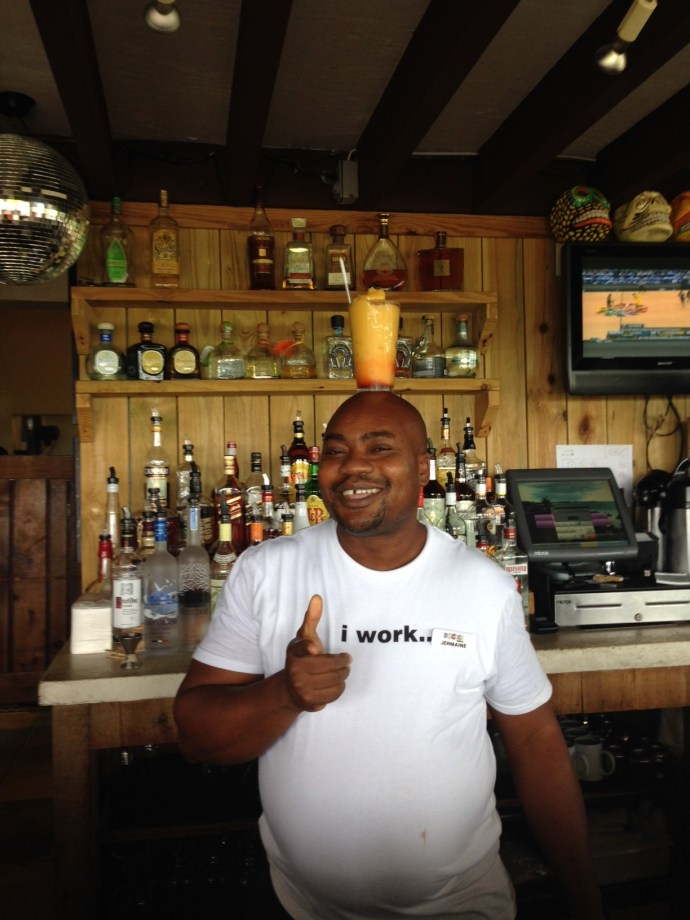 A very cheery bartender at Somewhere Cafe - the man had skills