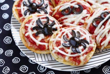 Mini pizzas decorated with spiders and mummies for a Halloween