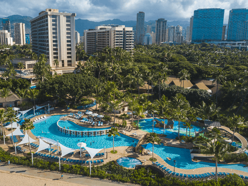 The giant pool surrounded by tropical greenery at the Hale Koa Hotel, an Armed Forces Recreation Center