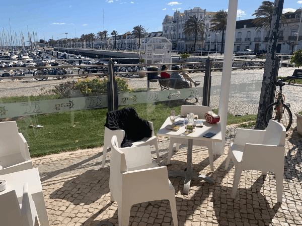 The table of an outdoor cafe overlooking a marina