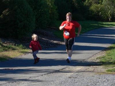 Poppy joins Mummy near the end of the Nelson Quarter Marathon race