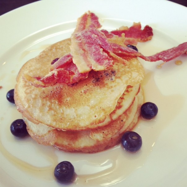 Blueberry buttermilk pancakes, smoked streaky bacon with maple syrup