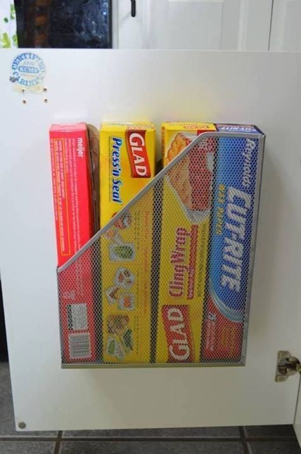This is one of those stationery holders, drilled onto the inside of a kitchen cupboard. Perfect for foil, cling film and all those other bits and bobs... found on pinterest.com
