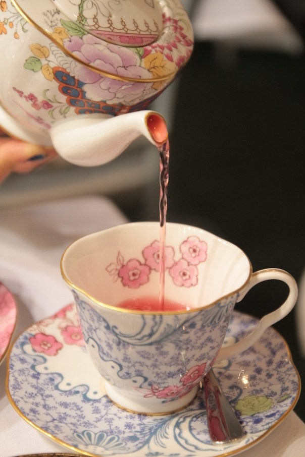 Pink tea being poured
