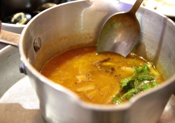 Fish soup in a saucepan