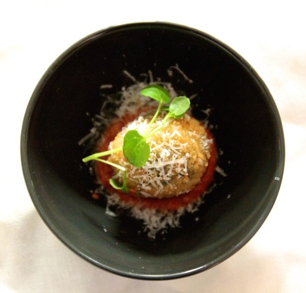 Spinach, chestnut and blue cheese arancini on a smoked tomato sauce
