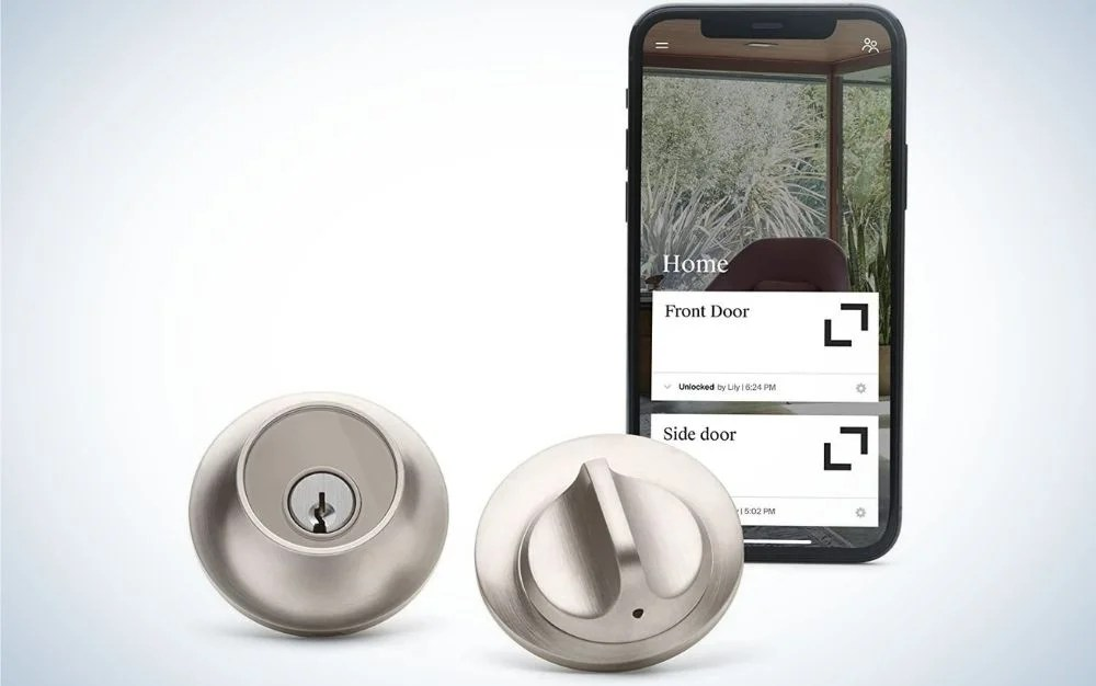 Round, satin nickel smart lock and a smartphone controlling the lock