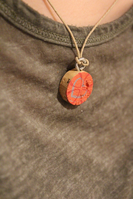 Wearing a handmade cork necklace | How to DIY Your Own Jewelry | Make your own necklace | From the Pop Shop America Blog