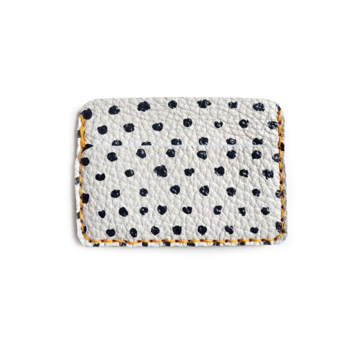 still photo of black and white polka dot wallet white leather wallet pop shop america