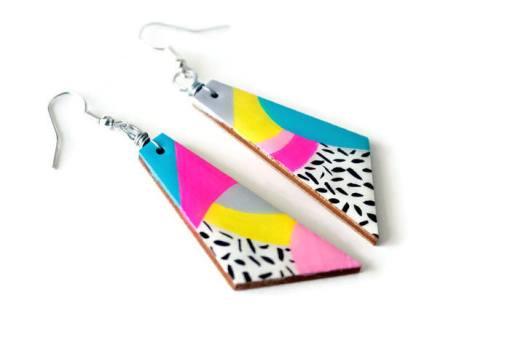 angle view of the max rainbow 80s dangle earrings