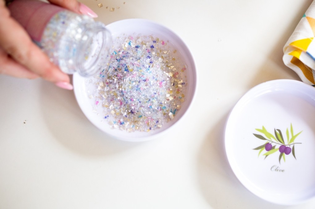 pour edible glitter in a small bowl pop shop america