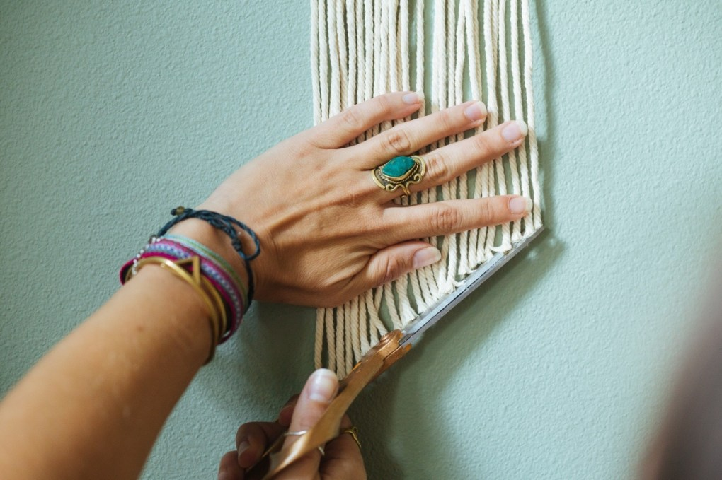 cut the rope at an angle to finish a boho macrame wall hanging