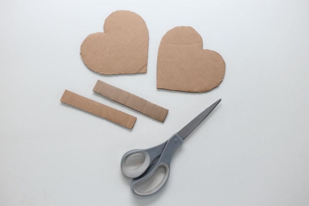 cut cardboard to make a diy heart pinata