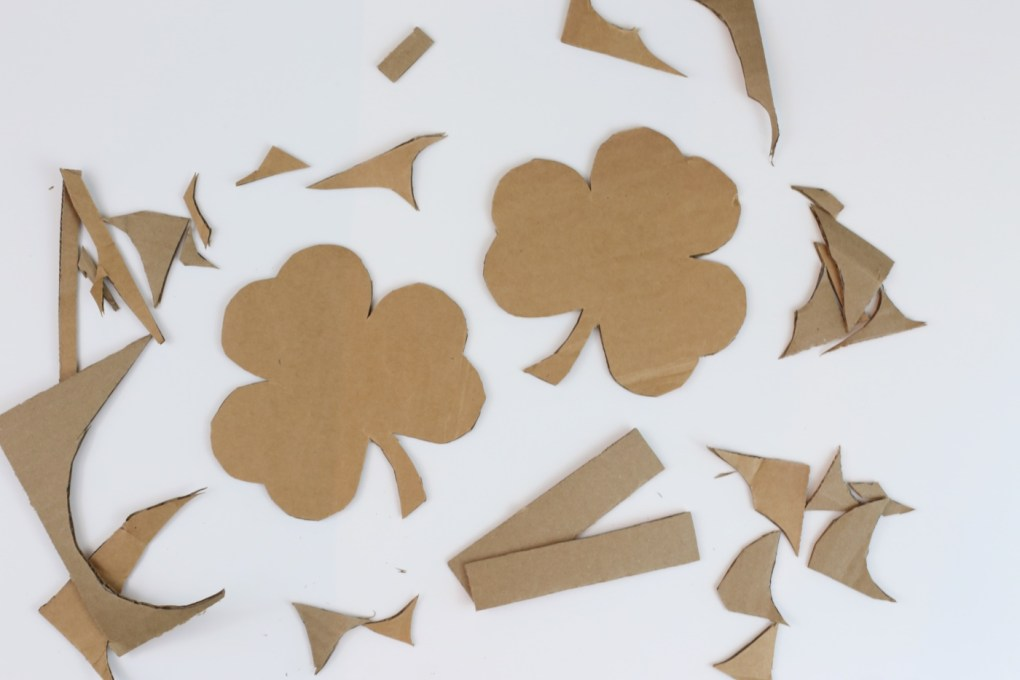 cut out the shamrock template to make a diy pinata craft tutorial