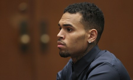 LOS ANGELES, CA - FEBRUARY 3: R&B singer Chris Brown appears in court for a probation progress hearing on February 3, 2014 in Los Angeles, California. Brown has been on probation since pleading guilty to assaulting his then girlfriend, singer Rihanna, after a pre-Grammy Awards party in 2009. He has been in anger management treatment program and performing community service requirements but failure to meet probation requirements could be even further complicated by assault charges he and bodyguard Christopher Hollosy face stemming from an incident outside the W hotel in Washington D.C. last October.   (Photo by David McNew/Getty Images)