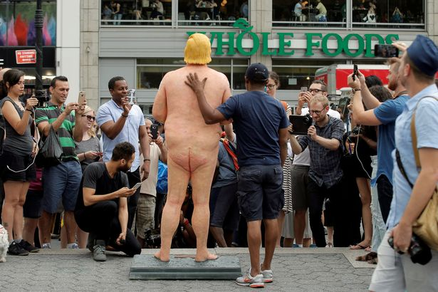 People-photograph-a-naked-statue-of-Republican-US-presidential-nominee-Donald-Trump-that-was-left[1]