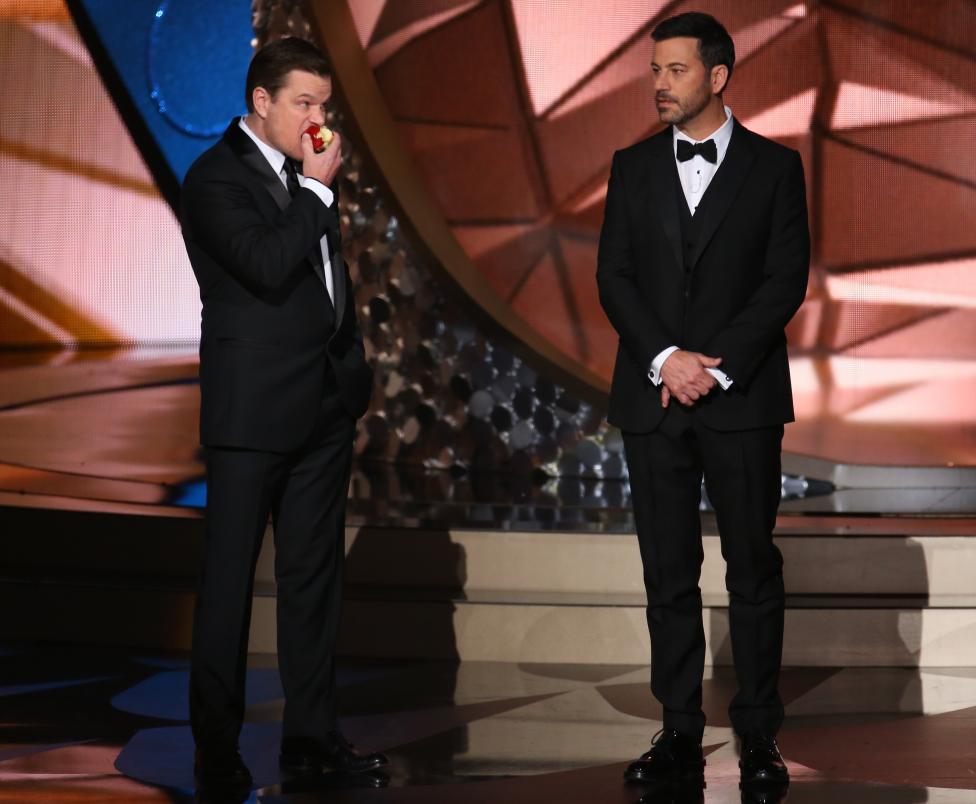 Actor Matt Damon (L) jokes around with show host Jimmy Kimmel. REUTERS/Mike Blake