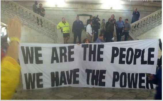 People have the power protest inside Ferguson City Hall protest October 13, 2014