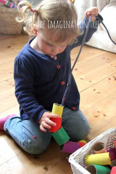 Toddler-threading-activity-with-giant-cardboard-beads-666x1000